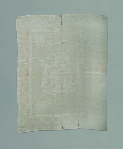 A French linen napkin Napoleon used at breakfast and pompously gave to an American traveller as a souvenir (circa 1815).