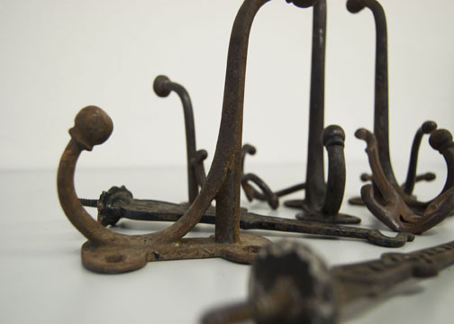 Antique cast-iron hangers and hooks